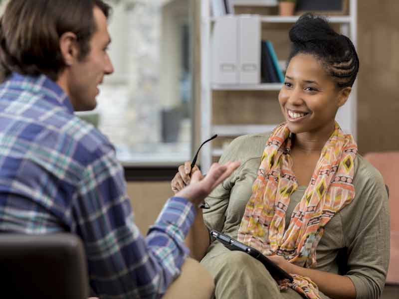 Christian counselor speaking with a client